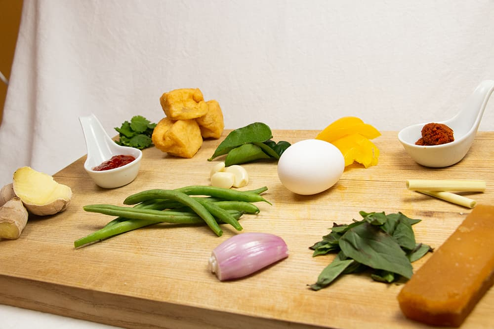Ingredients for curry soup on a cutting board.