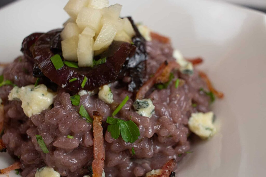 Red rice topped with red onions, pears and blue cheese.